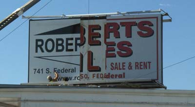 Three generations of Roberts Sales signage